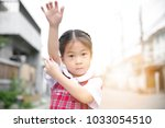 cute asian little girl in... | Shutterstock . vector #1033054510