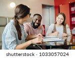 group of multiethnic university ... | Shutterstock . vector #1033057024