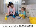 mom and daughter are cleaning...   Shutterstock . vector #1033060759