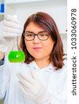 girl teen in the laboratory of... | Shutterstock . vector #1033060978