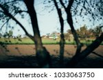 a farmer spraying pesticide at... | Shutterstock . vector #1033063750