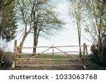 wooden gate on a field. farmland | Shutterstock . vector #1033063768