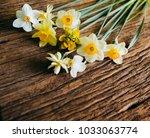 yellow flowers on wooden... | Shutterstock . vector #1033063774