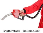 hand is holding red gasoline... | Shutterstock . vector #1033066630