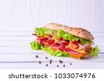 preparing a crusty fresh... | Shutterstock . vector #1033074976