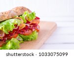 preparing a crusty fresh... | Shutterstock . vector #1033075099