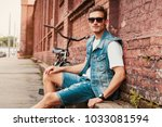 portrait of a trendy young man... | Shutterstock . vector #1033081594