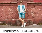 casual young man stands with... | Shutterstock . vector #1033081678