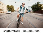 handsome hipster enjoying city... | Shutterstock . vector #1033088236