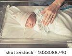 mother checking on newborn baby ... | Shutterstock . vector #1033088740