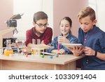 pupils doing biochemistry... | Shutterstock . vector #1033091404