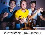 young men watching football... | Shutterstock . vector #1033109014