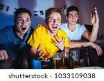young men watching football... | Shutterstock . vector #1033109038
