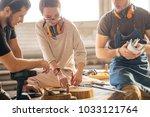 male carpenter showing... | Shutterstock . vector #1033121764