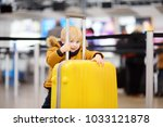 cute happy little boy with big... | Shutterstock . vector #1033121878