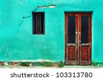 Old House Wall With Wooden Doo...