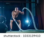 young man working out with... | Shutterstock . vector #1033139410