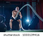young man working out with... | Shutterstock . vector #1033139416