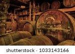 wine barrels and casks in old... | Shutterstock . vector #1033143166
