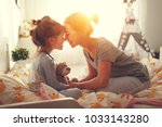 morning awakening. mother wakes ... | Shutterstock . vector #1033143280