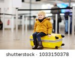 cute little boy with big yellow ... | Shutterstock . vector #1033150378
