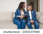 happy mother and son sitting on ... | Shutterstock . vector #1033157008