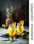 spicy pineapple margarita... | Shutterstock . vector #1033159870