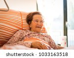 mature woman in hospital bed | Shutterstock . vector #1033163518