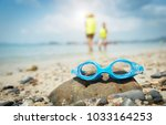 swimming goggles in the sand on ... | Shutterstock . vector #1033164253