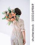 the girl in a tender dress is... | Shutterstock . vector #1033169869