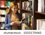 young beautiful woman reading a ... | Shutterstock . vector #1033170460