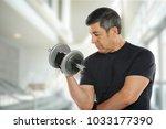 mature latin man working out... | Shutterstock . vector #1033177390