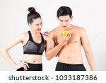 sportsman and sport girl bites... | Shutterstock . vector #1033187386