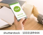 filing taxes online using... | Shutterstock . vector #1033189444