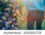 couple holding hands sunshine...   Shutterstock . vector #1033201729