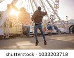 full of energy. full length... | Shutterstock . vector #1033203718