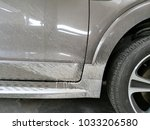 dirty car  spray mud wheel | Shutterstock . vector #1033206580