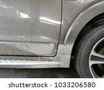 dirty car  spray mud wheel   Shutterstock . vector #1033206580