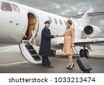 full length outgoing... | Shutterstock . vector #1033213474