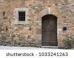 unique door in stone wall of... | Shutterstock . vector #1033241263