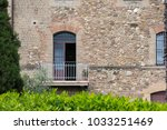 tuscan balcony with stone walls ... | Shutterstock . vector #1033251469