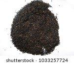 tea leaf after blended and... | Shutterstock . vector #1033257724