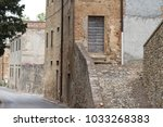 door in old medieval building... | Shutterstock . vector #1033268383