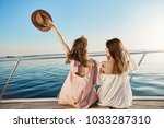 back portrait of two female... | Shutterstock . vector #1033287310