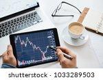 investor watching the change of ... | Shutterstock . vector #1033289503
