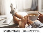 cup of tea and chill. woman... | Shutterstock . vector #1033291948