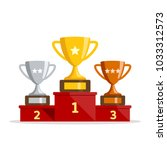 winners podium with cups.... | Shutterstock .eps vector #1033312573