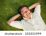 smiling man lying with both...   Shutterstock . vector #103331999