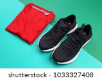 black sneakers and folded red... | Shutterstock . vector #1033327408
