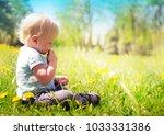 back view on a cute little... | Shutterstock . vector #1033331386